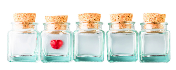 Red Valentine heart in corked bottles