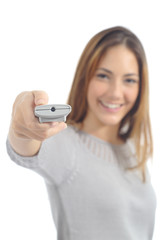 Woman pushing a button on a remote control