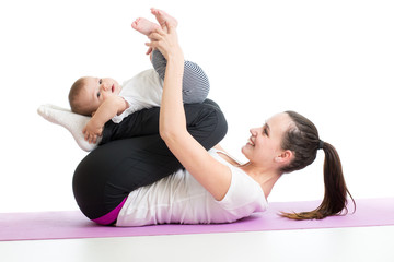 Mother doing yoga exercise with her baby