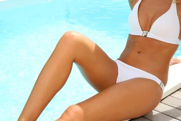 Closeup of woman's body in white bikini