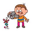 Boy filming a butterfly