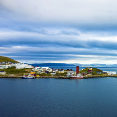 lighthouse and houses of Honningsvag, Norway