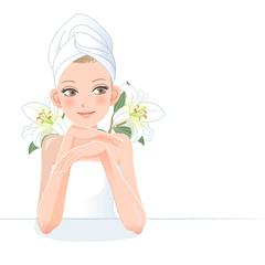 女性 エステ Beautiful gir with towel on her head and lily flowers