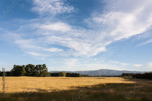 cirrus clouds above rural countryside