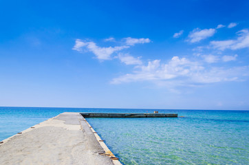 Silent Place, jetty at bright vibrant sky and sea water horizon