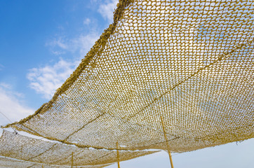 fishing net. Fishing tool equipment against blue sky