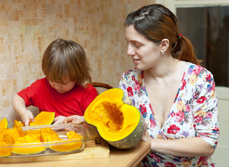mother with daughter cooking pumpkin