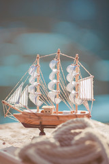 Composition of boats and nautical equipment. Sea theme decor