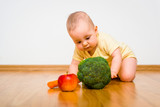 Baby eating fruits and vegetables