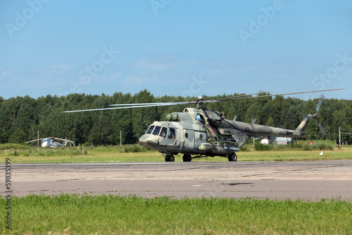 The military helicopter at the airfield