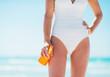 Closeup on young woman with sun block creme