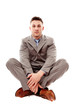 Positive businessman sitting cross legged