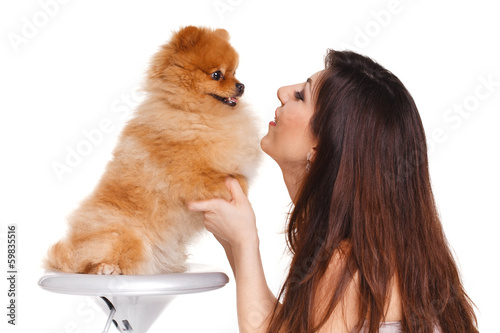 Happy woman with a beautiful dog - isolated over white
