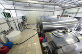 The workshop in dairy farm with chrome tanks for milk