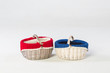 Two wicker baskets with knits inside in studio