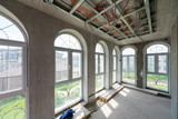 Interior house under construction with large windows