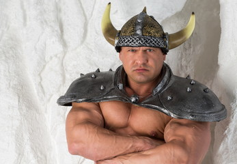 A muscular man in costume viking with armor
