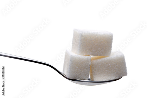 Spoon with sugar cubes isolated