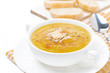 Cream soup of yellow lentils with vegetables in a bowl