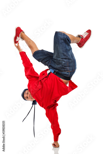 Dancer doing one hand stand