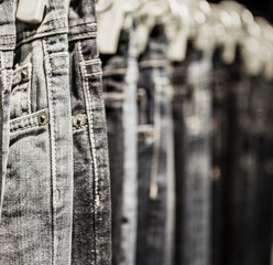 Garment rack with classic Jeans close up shot