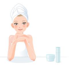 女性 美容 Pretty woman in towel smiling with skincare cosmetics