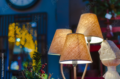 modern vibrant table lamp and christmas lights at background