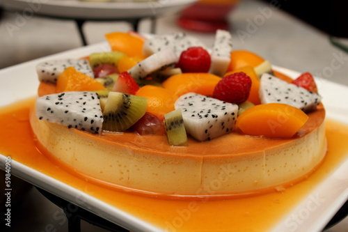 Deliciuos caramel custard close shot with fresh fruit