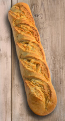 Baguette on rustic wood