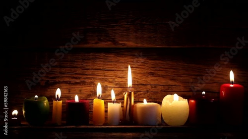 Candles in night in romantic mood on vintage wooden boards