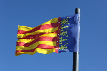 Flag of Comunidad Valenciana, region in Spain, moving in the win