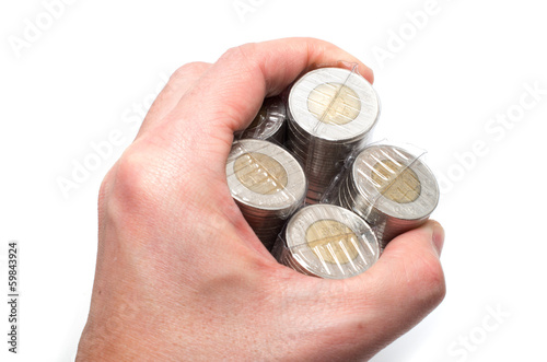 Male Asian hand holding a bunch of two dollar coins