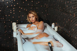 Beautiful young woman relaxing in a bath
