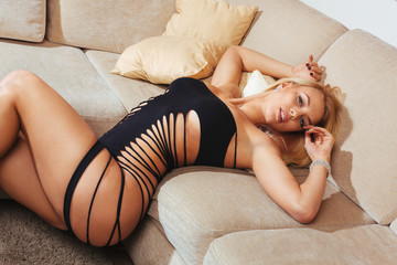 Portrait of beautiful blond woman relaxing on couch