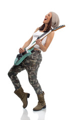 Beautiful young woman playing a guitar and singing