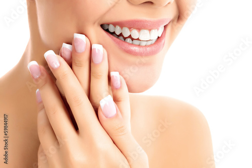 Face, hands and healthy white teeth of a woman