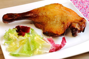 Duck leg with salad. Confit de canard