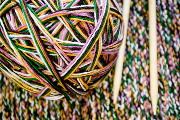 Great ball of colored yarn, wooden knitting needles