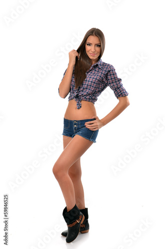 Full length portrait of a country girl with hand on hip