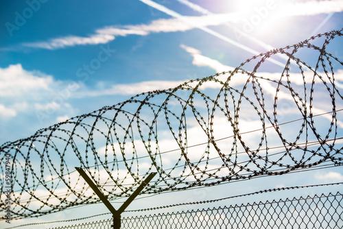 Leinwandbild Motiv fence with barbed wire