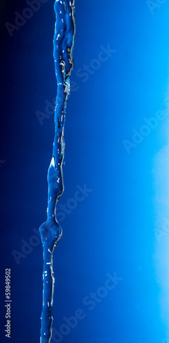 a jet of water on a blue background