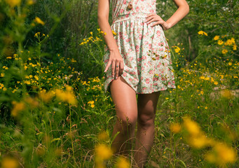 Beautiful woman walks at the country. Wet, casual dress, barefoo
