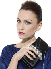 woman with fashion makeup and red lips holding purse