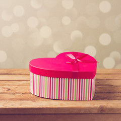 Valentine's day gift box over bokeh background