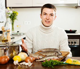 Handsome man with trout fish