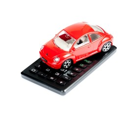 toy car and calculator concept for costs