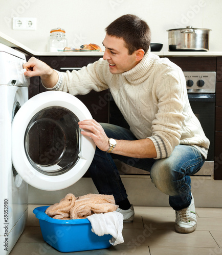 Man loading the washing machine