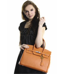 beautiful young woman with modern a handbag