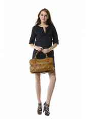The fashionable young woman with bag walking show in studio