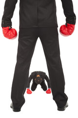 businessman give up the competition with boxing gloves